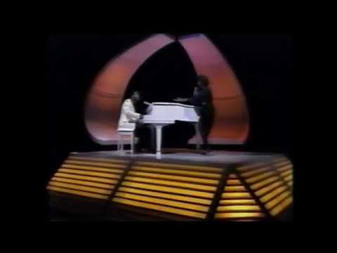 1981: Billy Preston & Syreeta sing With You I'm Born Again.