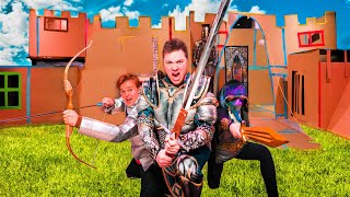 3 STORY BOX FORT CASTLE WARS!!  Sword Fighting, Archery & More!