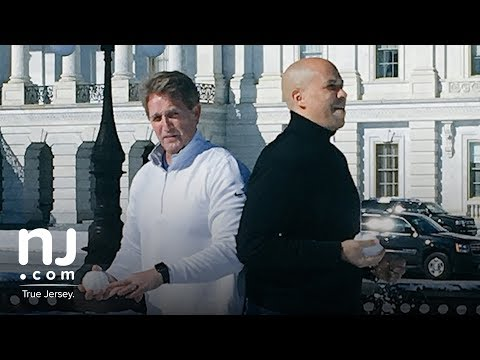 Cory Booker And Jeff Flake Have A Snowball Fight On Capitol Hill