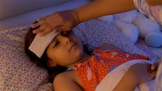 Indian cute girl suffering from fever and being taken care of by her lovely mother - Sick and Ill