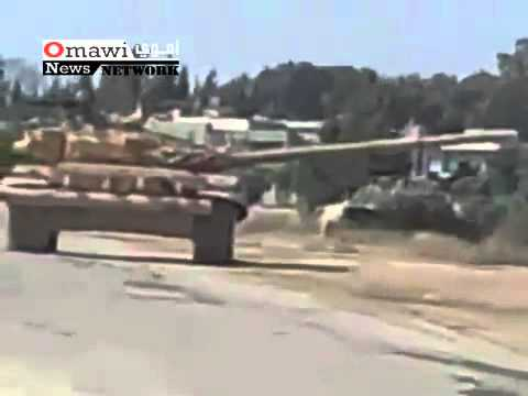 Syria - Homs - Ar Rastan - 20110718 - Three main battle tanks and soldiers in a street