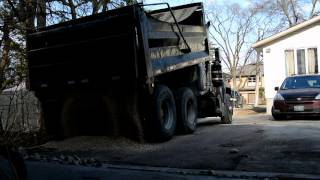 Dump Truck Dumping 12 yards Gravel