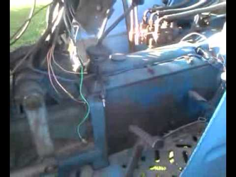 how to change oil on a leland 344 tractor
