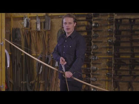 EXCLUSIVE: Sam Heughan Reveals Jamie's Season 3 Weapons & Why He Punched Tobias Menzies in the Fa…