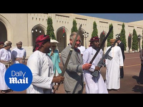 Prince Charles takes part in ancient sword dance as he visits Oman - Daily Mail