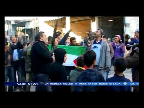 Palestinians in refugee camps in Saida celebrate the death of Ariel Sharon