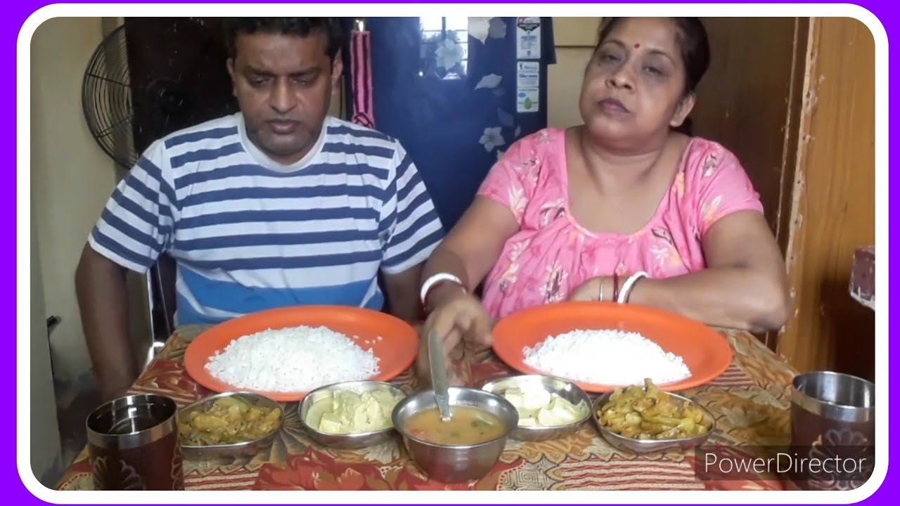 Eating veg lunch with Bhaat. Tomator dal.sobji.Dudh poneer