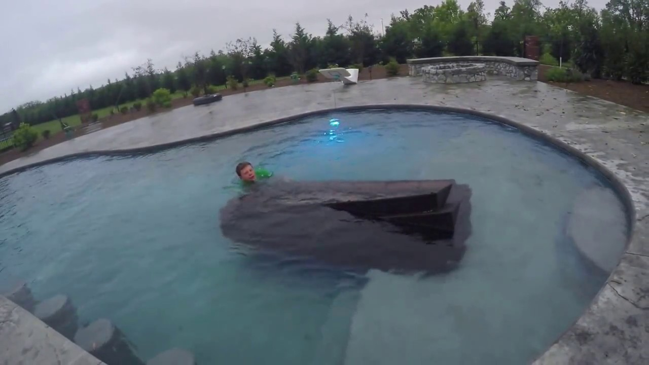 Charming Jumping In To A Freezing Cold Pool To Get A Couch Out Of The Water
