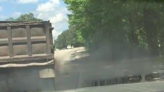Carolina Coal Roller: Dump truck dumping black smoke