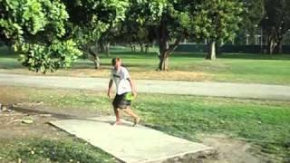 High speed of Patrick Sweeney Barefoot disc golf drive in a Sport Kilt At El Dorado Long Beach Ca