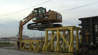 Cat 319D LN climbing onto rail car thumbnail