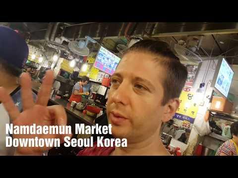 Eating Bibimbap at Namdaemun Market in Seoul Korea is only $5 for a LOT of food.
