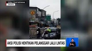 Polisi 'Nemplok' di Kap Mobil Hentikan Pelanggar Lalu Lintas
