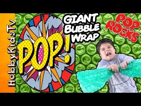 World's Biggest BUBBLE WRAP Surprise Toy Egg Challenge! Giant Gigaball Pop Rocks HobbyKidsTV