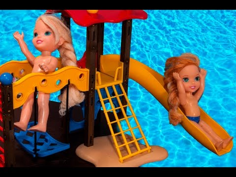 Elsa and Anna toddlers have a milk bath and play in the water with their friends at the waterpark