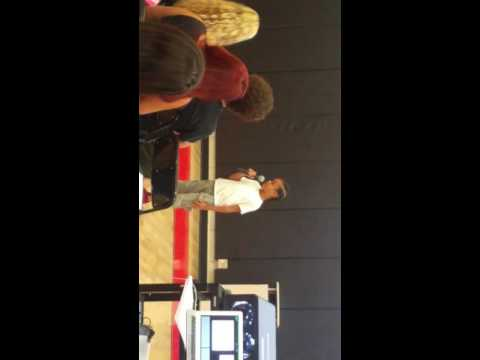 Denim speaking at Dream Charter School