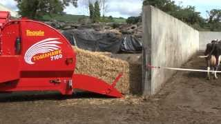 tomahawk 7100 tractor mounted bale processor