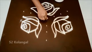 Simple rose kolam with 7 to 4 interlaced dots