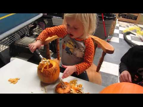 Piper and Sawyer Carving Pumpkins