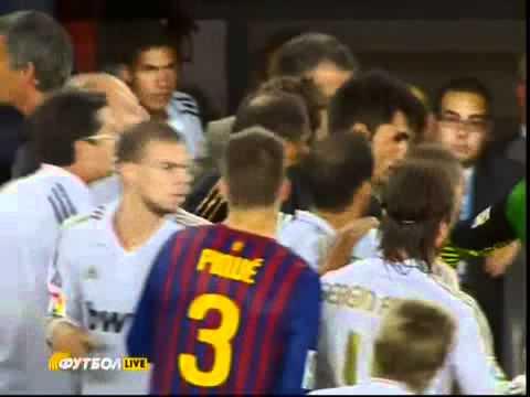 Jose Mourinho pokes the eye of Barcelona coach Tito Vilanova