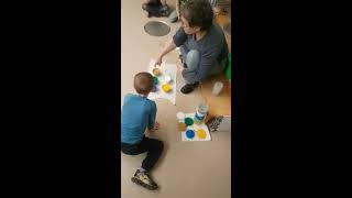 Mixing paint layers for an acrylic pour with children
