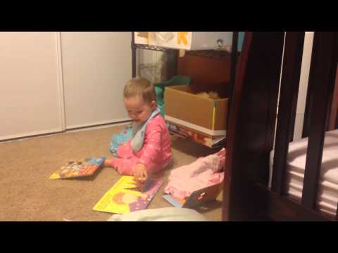 Toddler reading on her own- Avy loves books!