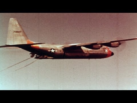 HD Stock Footage JC-130A Air Recovery of Space Capsule, Space Program 1960's
