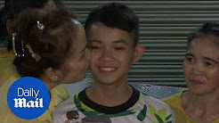 Heartwarming moment rescued Thai cave boy returns home to family - Daily Mail