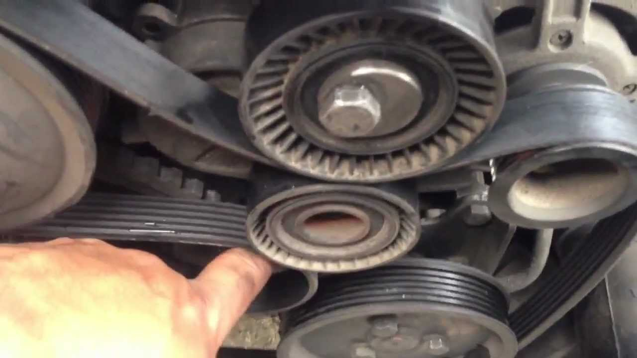 how to completely replace belt tensioner 97