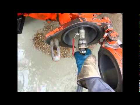 cleaning the concrete pump boomlines and hopper.wmv