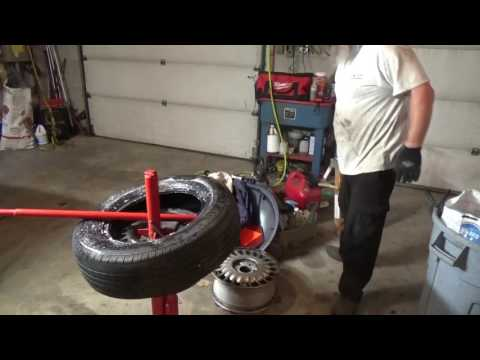 Changing a tire with a manual tire changer- Is it worth it?