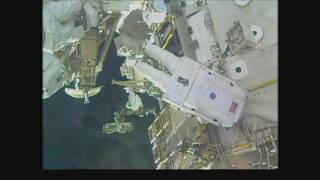 Space Station Crew Members Conduct a Spacewalk for Battery Replacement on the Outpost