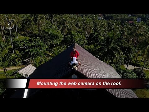 Mounting the web camera on the roof in Koh Samui.