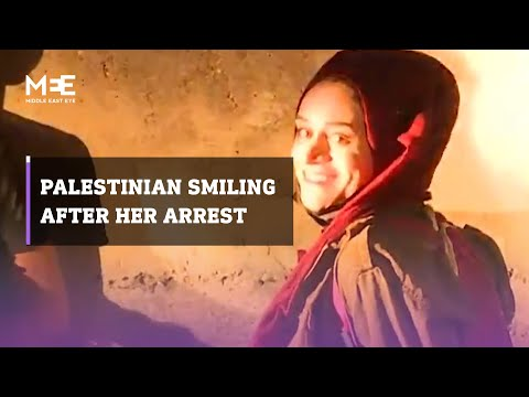 Palestinian woman smiles after being arrested