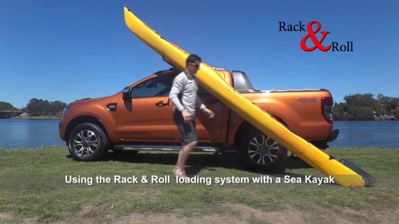 loading a sea kayak with rack roll