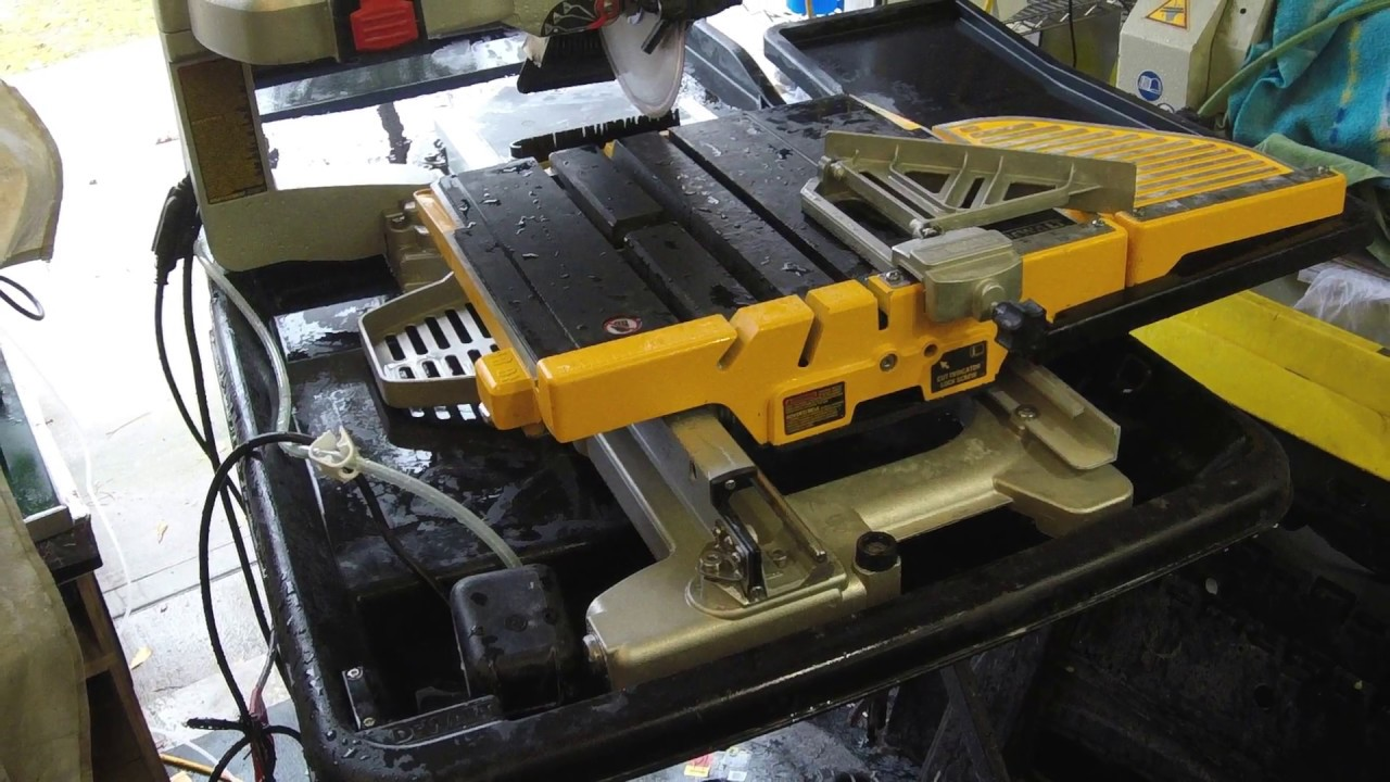 cleaning a wet dewalt tile saw used to cut glass