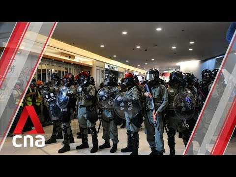 Hong Kong plain clothes police arrest protesters in mall amid violent scuffles