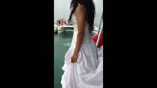 Bride jumps into ocean