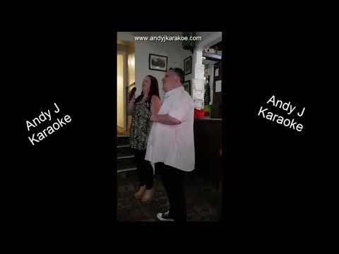 Eileen and Lee singing a classic karaoke duet