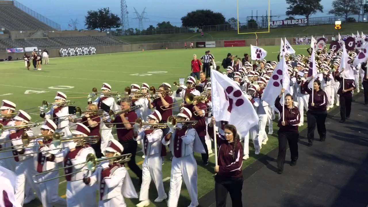Plano Senior High School Band march in with Alumni