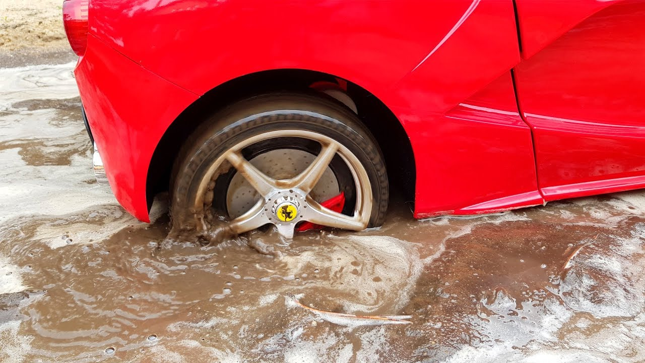 Ferrari power wheels car stuck in the mud