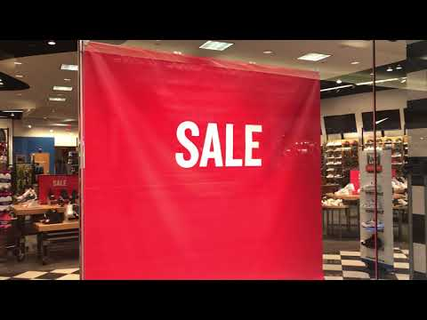 Pan Left to A Big SALE Sign At Shoes Store - Free Stock Footage