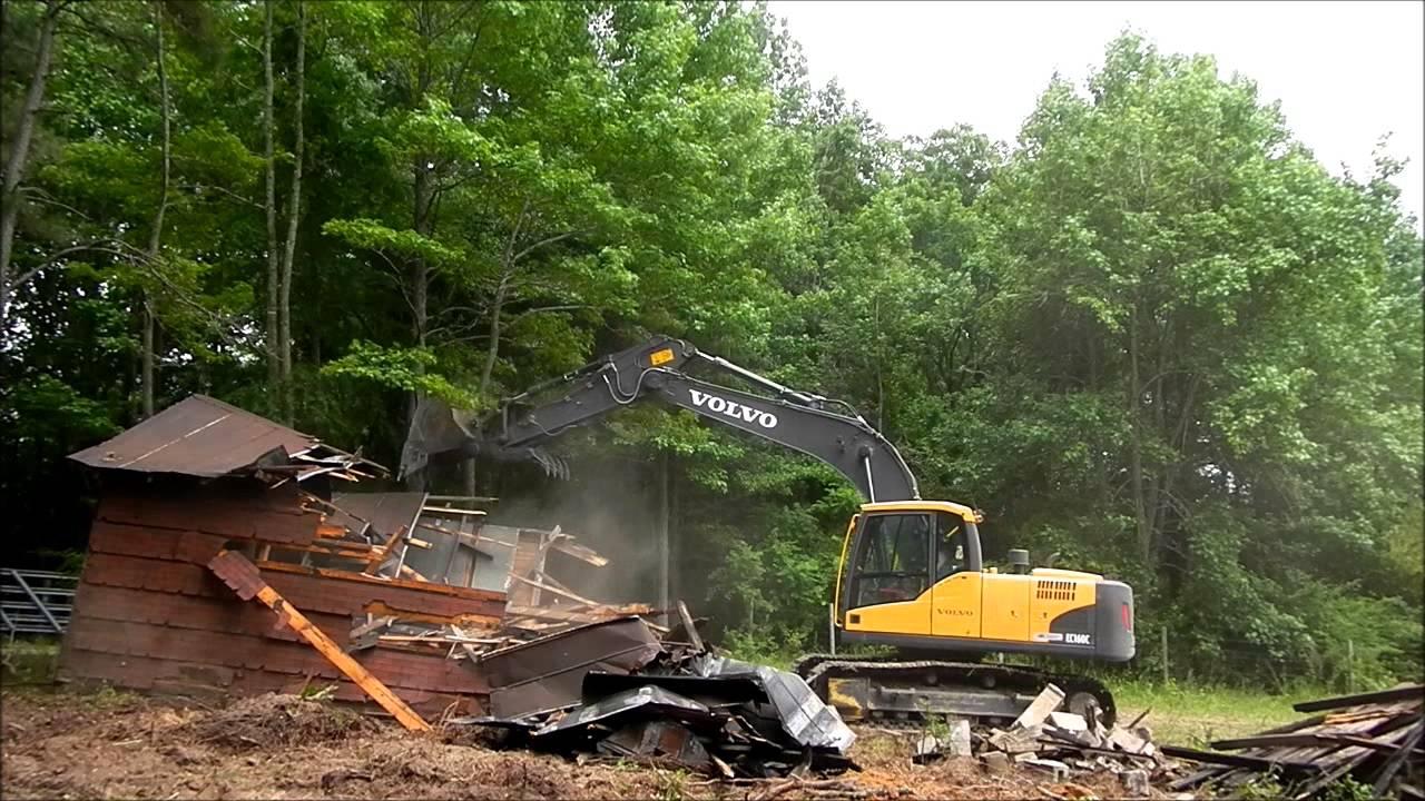 Excavator Demoing Old House