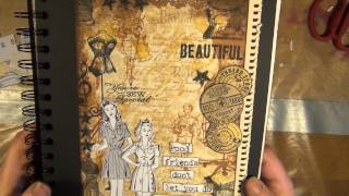 an affirmation album made with the collage stamping techique - new prima doll and tim holtz stamps