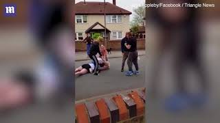 Thug attacks mother with a chainsaw during mass street brawl