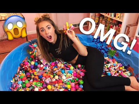 😱 SWIMMING IN MY GIANT LIP BALM COLLECTION!
