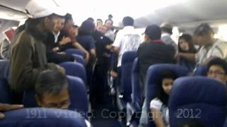 Air Rage on Lion Air. A Violent and Mentally unstable passenger smoking in the cabin.(A violent and mentally unstable passenger was smoking in the cabin. He refused to put out the cigarette, and became violent. Relatives on board the plane tried ..., 2012-07-01T05:17:01.000Z)
