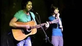 Jian Ghomeshi of CBC playing guitar