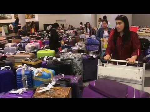 عودة مئات الفلبينيات إلى بلادهن بعد مقتل العاملة المنزلية في الكويت…  - 21:21-2018 / 2 / 21