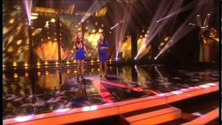 Kelly performs with Una Healy from The Saturdays.